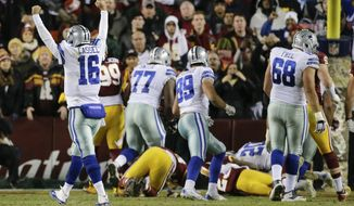 Dallas Cowboys quarterback Matt Cassel (16) celebrates running back Darren McFadden's touchdown during the second half of an NFL football game against the Washington Redskins in Landover, Md., Monday, Dec. 7, 2015. (AP Photo/Mark Tenally)
