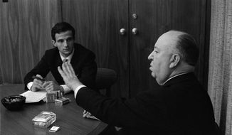 "This 1962 image released by Cohen Media Group shows Francois Truffaut, left, and director Alfred Hitchcock in a scene from Kent Jones' documentary, ""Hitchcock/Truffaut."" The new documentary by critic, filmmaker and New York Film Festival head Kent Jones, is about that extraordinary meeting and its long reverberations through cinema. (Philippe Halsman/Cohen Media Group via AP)"