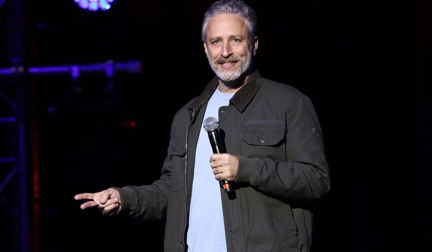 """FILE - In this Tuesday, Nov. 10, 2015, file photo, comedian Jon Stewart performs at the 9th Annual Stand Up For Heroes event, presented by the New York Comedy Festival and The Bob Woodruff Foundation, at the Theater at Madison Square Garden in New York. Stewart has returned to """"The Daily Show"""" where he made a push to renew a law that provides health benefits for first responders who became ill after the Sept. 11 terror attacks. Stewart was a guest on the """"Daily Show with Trevor Noah"""" on Monday, Dec. 8, 2015. (Photo by Greg Allen/Invision/AP, File)"""