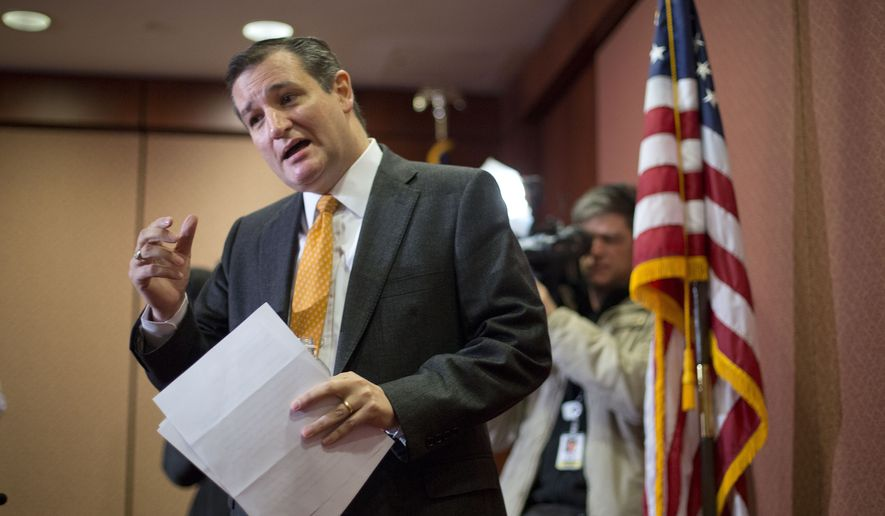 Republican presidential candidate Sen. Ted Cruz, R-Texas stops to answer a question from member of the media following a news conference with Texas Gov. Greg Abbott, about the resettlement of Syrian refugees in the U.S., during a news conference on Capitol Hill in Washington, Tuesday, Dec. 8, 2015. (AP Photo/Pablo Martinez Monsivais)