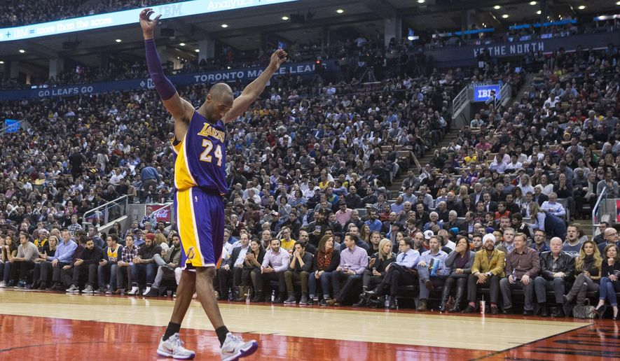 Los Angeles Lakers's Kobe Bryant stretches out as he returns to the court during the second half of an NBA basketball game against the Toronto Raptors in Toronto, Monday, Dec. 7, 2015. (Chris Young/The Canadian Press via AP)