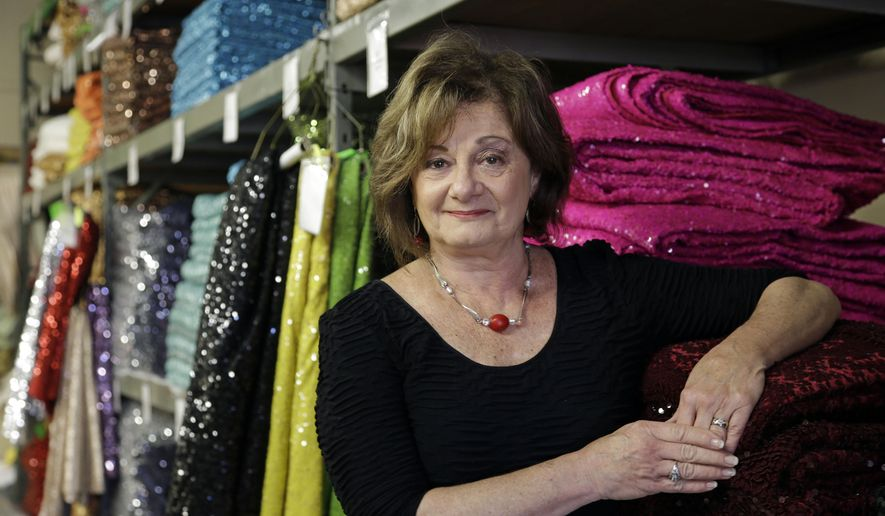 In this photo taken Monday, Dec. 7, 2015, CE Rental co-owner Vicki Phaneuf poses for a photo at her party rental company in Raleigh, N.C. Small business owners are on edge as they wait to see if Congress will approve a big increase in the tax break they get to buy new equipment this year. (AP Photo/Gerry Broome)