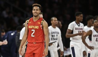 Maryland's Melo Trimble (2) reacts after a play during the second half of an NCAA college basketball game against Connecticut Tuesday, Dec. 8, 2015, in New York. Maryland won 76-66. (AP Photo/Frank Franklin II)