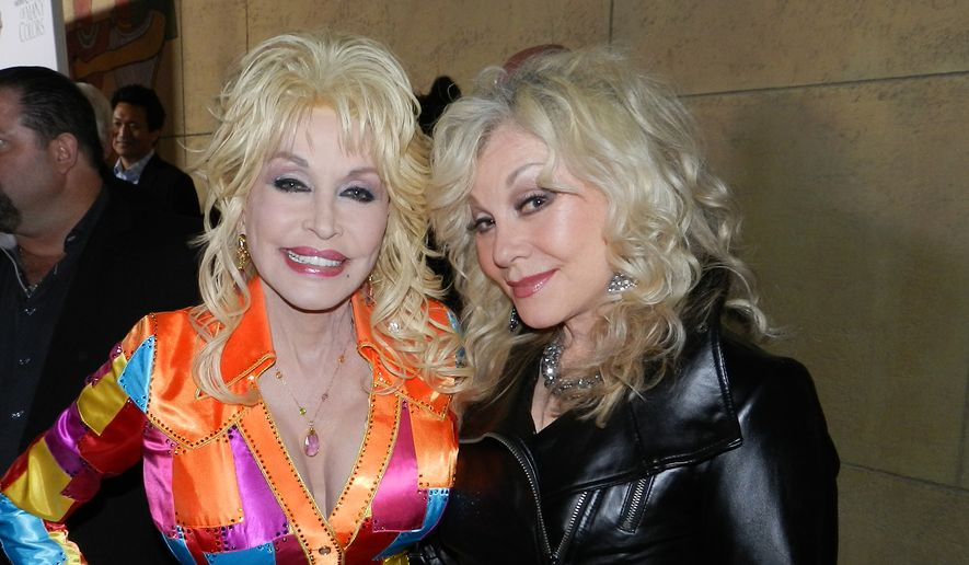 """Dolly Parton, left, and sister Stellar Parton, right, at the premiere of """"Coat of Many Colors"""" in Los Angeles. (Dave Kapp)"""