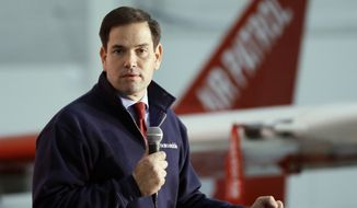 Republican presidential candidate, Sen. Marco Rubio, R-Fla., addresses supporters at the Oakland County International Airport, Wednesday, Dec. 9, 2015, in Waterford Township, Mich. (AP Photo/Carlos Osorio)