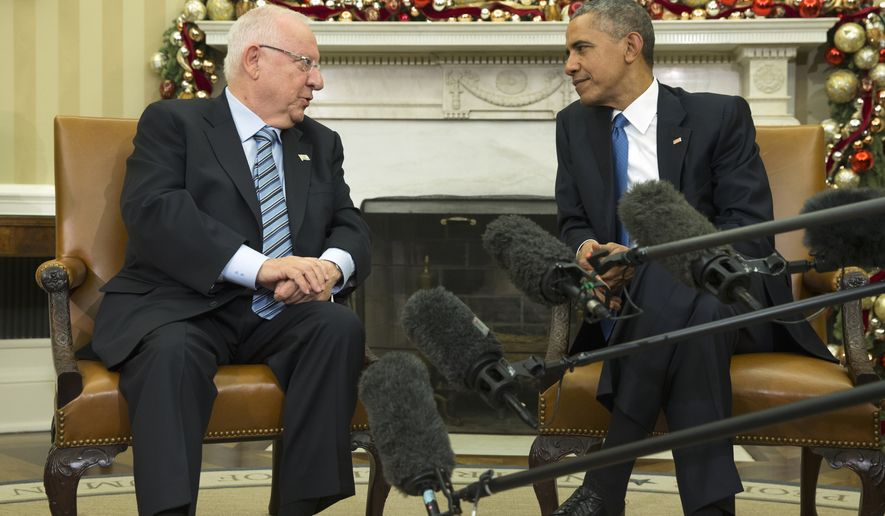 President Barack Obama meets with Israeli President Reuven Rivlin in the Oval Office of the White House in Washington, Wednesday, Dec. 9, 2015. (AP Photo/Evan Vucci)