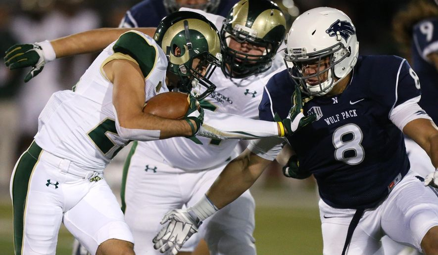 FILE - In this Oct. 11, 2014, file photo, Colorado State's Joe Hansley (25) runs against Nevada defender Ian Seau (8) during the first half of an NCAA college football game in Reno, Nev. Colorado State's Sam Carlson (71) is at rear. - Mountain West officials pleaded with anyone they could find to prevent two teams from the conference ending up in the same bowl. Nevada and and Colorado State still ended up in the Arizona Bowl and the conference is not happy. (AP Photo/Cathleen Allison, File)