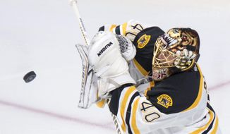 Boston Bruins' goalie Tuukka Rask deflects a shot from the Montreal Canadiens during second period NHL hockey action, in Montreal, on Wednesday, Dec. 9, 2015. (Paul Chiasson/The Canadian Press via AP)