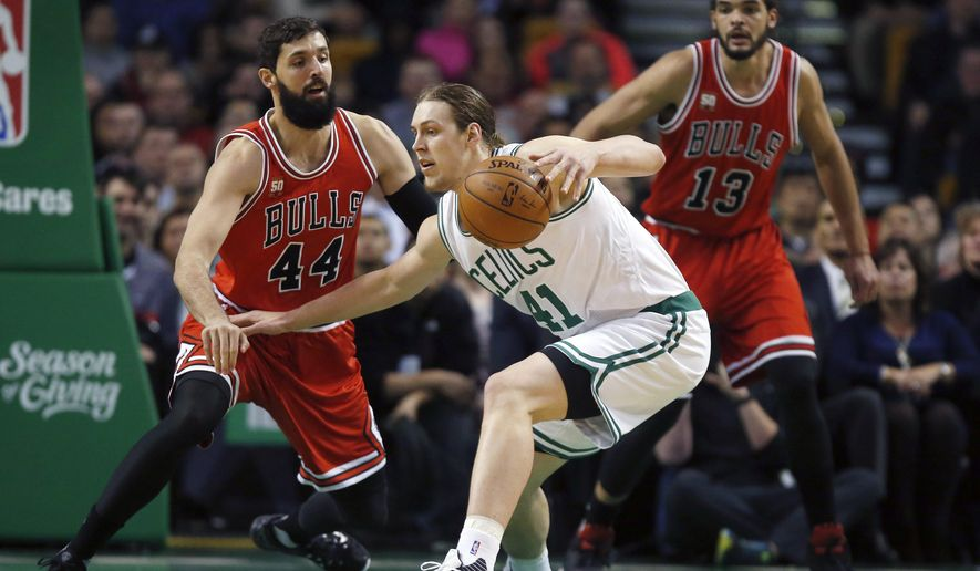 Chicago Bulls' Nikola Mirotic (44) defends against Boston Celtics' Kelly Olynyk (41) during the first half of an NBA basketball game in Boston, Wednesday, Dec. 9, 2015. (AP Photo/Michael Dwyer)