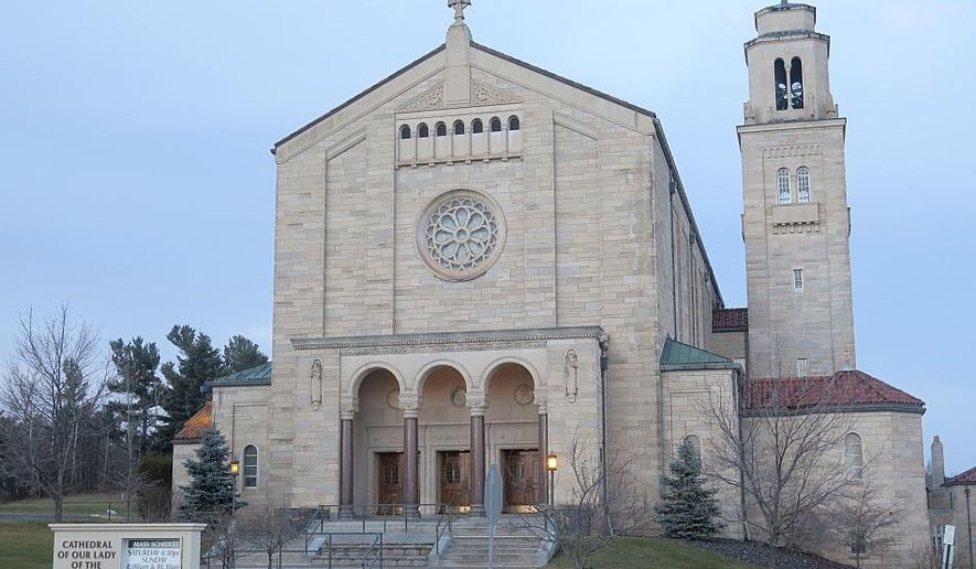 This photo shows the Cathedral of Our Lady of the Rosary in Duluth, Minn., Monday, Dec. 7, 2015. The Diocese of Duluth, a sprawling but sparsely populated Roman Catholic diocese in northeastern Minnesota, filed an emergency petition for federal bankruptcy protection Monday after a jury found it partially responsible for millions of dollars awarded in a clergy sex abuse case last month. (Dan Kraker/Minnesota Public Radio via AP) MANDATORY CREDIT