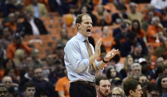 Syracuse's Mike Hopkins, works the sideline during an NCAA college basketball game against Colgate in Syracuse, N.Y., Tuesday, Dec. 8 , 2015. Syracuse won 78-51. (AP Photo/Heather Ainsworth)