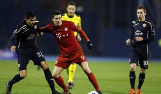 Bayern's Robert Lewandowski, center and Zagreb's Leonardo Sigali fight for the ball during the Champions League Group F soccer match between Dinamo Zagreb and Bayern Munich in Zagreb, Croatia, Wednesday, Dec. 9, 2015. (AP Photo/Darko Bandic)