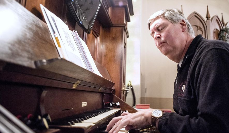 Jim Athas plays a song, Nov. 24, 2015, at First United Methodist Church of Whitewater in Whitewater, Wis., where he has served 40 years as the organist. (Angela Major/The Janesville Gazette via AP)