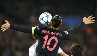 PSG's Zlatan Ibrahimovic heads the ball during the Champions League Group A soccer match between PSG and FC Shakhtar Donetsk at the Parc des Princes stadium in Paris, Tuesday, Dec. 8, 2015. (AP Photo/Francois Mori)