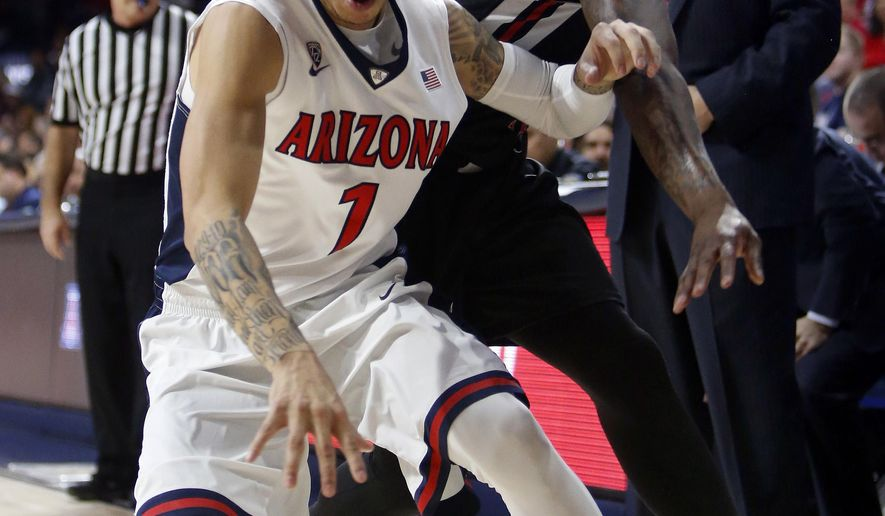 Arizona guard Gabe York (1) steals the ball from Fresno State guard Marvelle Harris during the first half of an NCAA college basketball game, Wednesday, Dec. 9, 2015, in Tucson, Ariz. (AP Photo/Rick Scuteri)