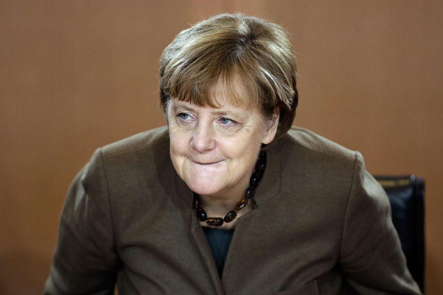 German Chancellor Angela Merkel arrives for German government's weekly cabinet meeting in Berlin, Wednesday, Dec. 9, 2015. (AP Photo/Markus Schreiber)