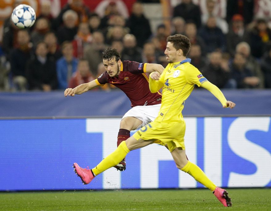 Roma's Alessandro Florenzi kicks the ball past BATE's Evgeny Yablonsky, right, during the Champions League, group E soccer match between Roma and Bate Borisov, at Rome's Olympic stadium Wednesday, Dec. 8, 2015. (AP Photo/Andrew Medichini)