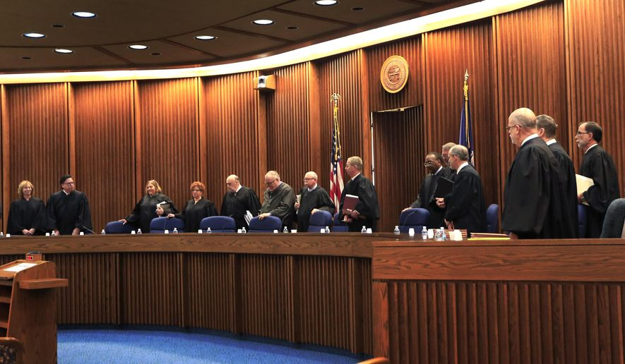 The full 14-member of the Kansas Court of Appeals enter the Supreme Court courtroom in Topeka, Kan., to hear oral arguments Wednesday, Dec. 9, 2015.  The lawsuit against a Kansas ban on a common second-trimester procedure has forced the state Court of Appeals to consider how much the state constitution protects abortion rights. (AP Photo/Orlin Wagner)