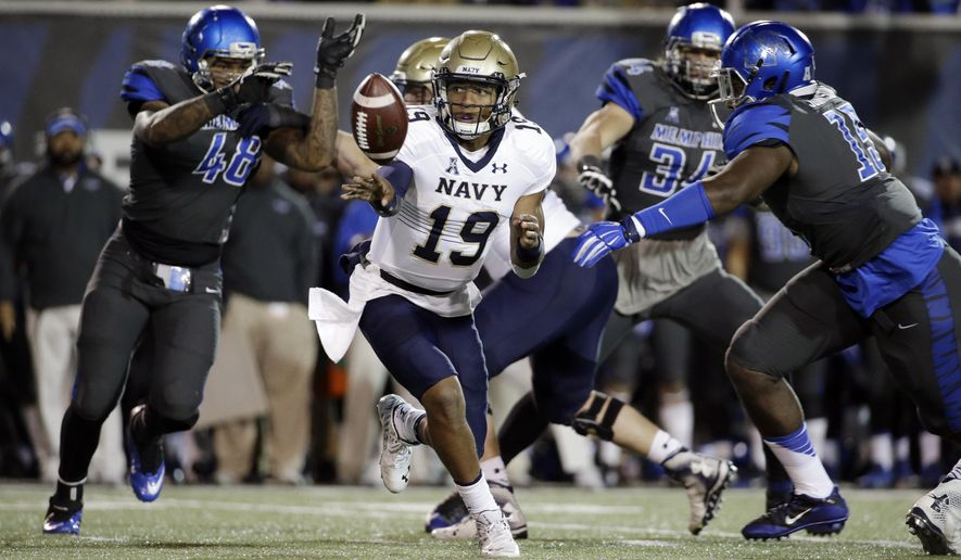 FILE - In this Nov. 7, 2015, file photo, Navy quarterback Keenan Reynolds (19) playing against Memphis in the first half of an NCAA college football game in Memphis, Tenn.  Keenan Reynolds has already enjoyed a sensational, record-setting career at Navy. On Saturday, Dec. 12, 2015, he hopes to add another milestone to his impressive list of accomplishments: first quarterback to go 4-0 as a starter in the Army-Navy series. (AP Photo/Mark Humphrey, File)
