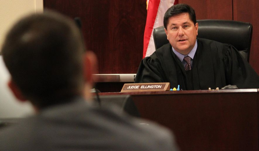 State District Judge T. Glenn Ellington talks with prosecutors during a motions hearing in the case of former New Mexico Secretary of State Dianna Duran in Santa Fe, N.M., on Tuesday, Dec. 8, 2015. Duran is scheduled to be sentenced Dec. 14 on felony embezzlement and misdemeanor charges related to siphoning thousands of dollars from her election account. (AP Photo/Susan Montoya Bryan)