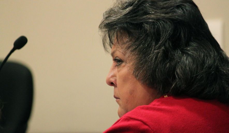 Former New Mexico Secretary of State Dianna Duran listens to prosecutors during a motions hearing in Santa Fe, N.M., on Tuesday, Dec. 8, 2015. Duran is scheduled to be sentenced Dec. 14 on felony embezzlement and misdemeanor charges related to siphoning thousands of dollars from her election account. (AP Photo/Susan Montoya Bryan)