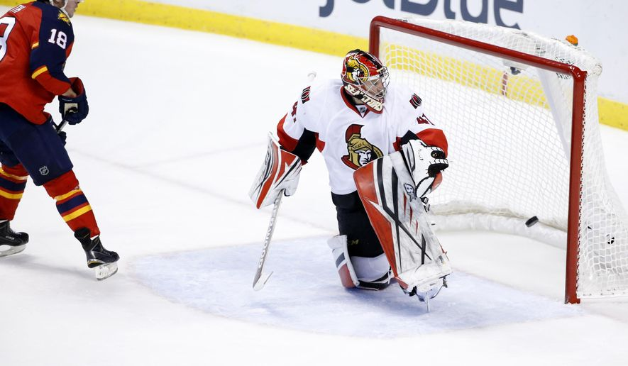 Florida Panthers right wing Reilly Smith (18) scores a goal against Ottawa Senators goalie Craig Anderson (41) during the second period of an NHL hockey game, Tuesday, Dec. 8, 2015 in Sunrise, Fla. (AP Photo/Wilfredo Lee)