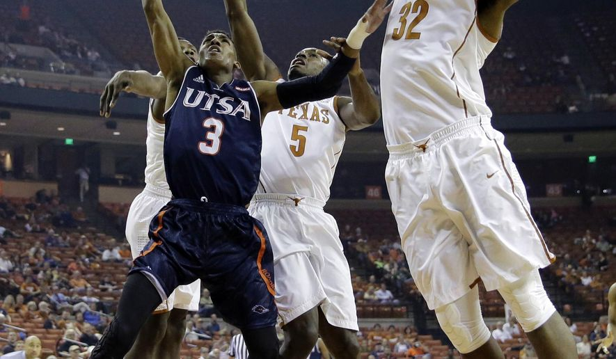 UTSA guard Gino Littles (3) shoots over Texas guard Kendal Yancy (5) and forward Shaquille Cleare (32) during the first half of an NCAA college basketball game, Tuesday, Dec. 8, 2015, in Austin, Texas. (AP Photo/Eric Gay)