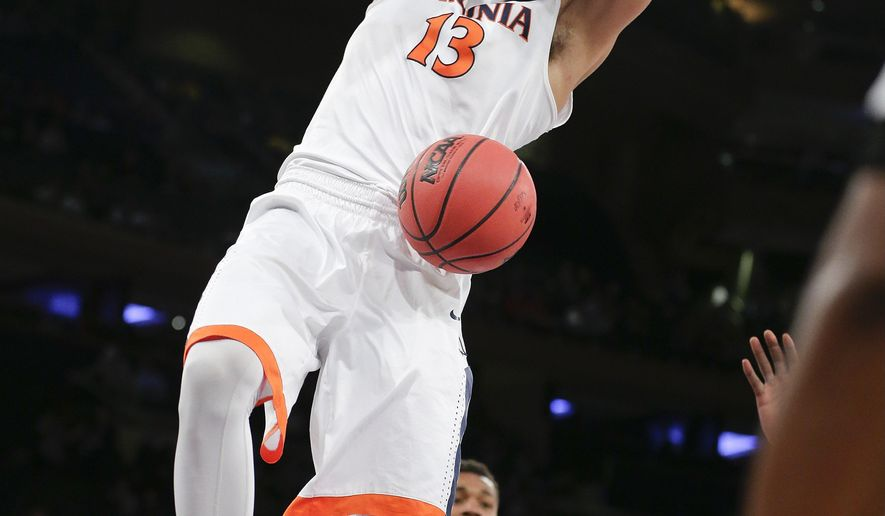 Virginia's Anthony Gill (13) dunks the ball as West Virginia's Daxter Miles Jr. (4) watches during the first half of an NCAA college basketball game, Tuesday, Dec. 8, 2015, in New York. (AP Photo/Frank Franklin II)
