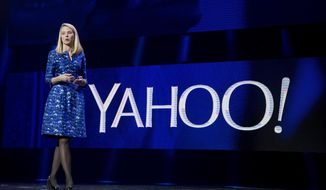 Yahoo President and CEO Marissa Mayer speaks during the International Consumer Electronics Show in Las Vegas, in this Jan. 7, 2014, file photo. Yahoo announced Wednesday, Dec. 9, 2015, it is scrapping its original plan to spin off its prized stake in China's Alibaba Group and will instead break off the rest of its business into a new company. (AP Photo/Julie Jacobson, File)