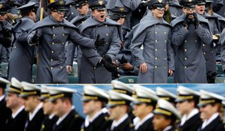 Army's cadets won't need heavy coats to call out to Navy midshipmen as they march on the field before the game on Saturday in Philadelphia. Temperatures are forecast to be in the 60s. (Associated Press)