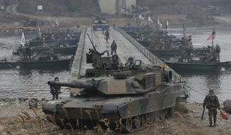 U.S. M1A2 SEP Abrams battle tanks cross the Hantan river during a river crossing operation, part of an annual joint military exercise between South Korea and the United States against a possible attack from North Korea, in Yeoncheon, south of the demilitarized zone that divides the two Koreas, South Korea, Thursday, Dec. 10, 2015. It was the last day of the exercise by the two allies that began on Dec. 1.  (AP Photo/Ahn Young-joon)