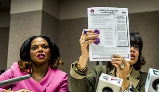 Flint Mayor Karen Weaver, right, and City Administrator Natasha Henderson address questions about adding supplemental phosphates to the city's water during a news conference, Thursday, Dec. 10, 2015 at City Hall in Flint, Mich. The city says phosphates are being added to drinking water in an effort to help deal with problems with lead caused by the city's earlier use of Flint River water. (Jake May/The Flint Journal-MLive.com via AP)