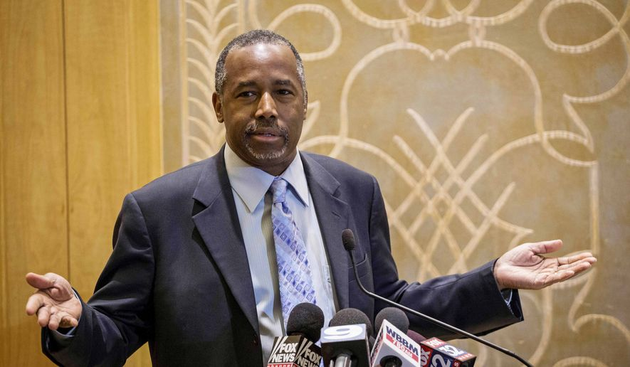 Republican presidential candidate Ben Carson takes questions from reporters Thursday, Dec. 10, 2015, at the Peninsula Hotel in Chicago after a roundtable meeting with pastors. (Rich Hein/Chicago Sun-Times via AP)