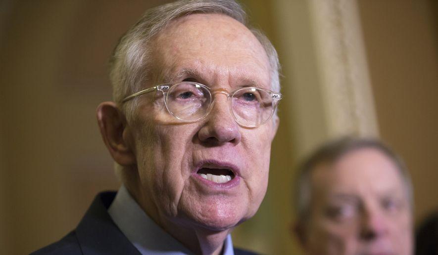 Senate Minority Leader Harry Reid, Nevada Democrat, speaks on Capitol Hill in Washington on Dec. 1, 2015. (Associated Press) **FILE**