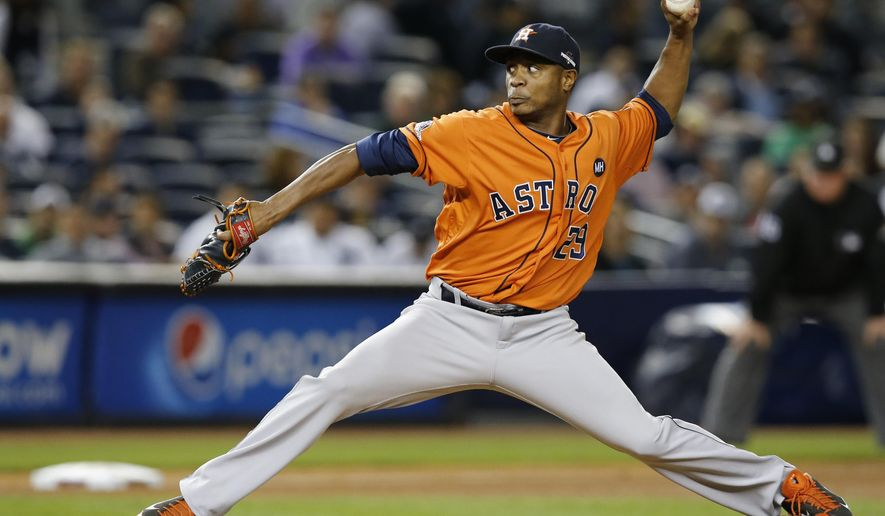 FILE - In this Oct. 6, 2015 file photo, Houston Astros relief pitcher Tony Sipp throws during the seventh inning of the American League wild card baseball game against the New York Yankees at Yankee Stadium in New York. A person familiar with the negotiations says  Sipp has agreed to an $18 million, three-year contract to remain with the Astros. The person spoke on condition of anonymity Thursday, Dec. 10, 2015 because the agreement was pending a physical and had not been announced.  (AP Photo/Kathy Willens)