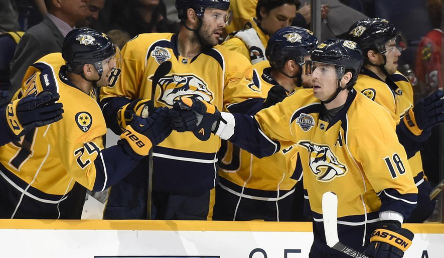 Nashville Predators right wing James Neal (18) is congratulated after scoring a goal in the first period of an NHL hockey game against the Chicago Blackhawks Thursday, Dec. 10, 2015, in Nashville, Tenn. (AP Photo/Mark Zaleski)
