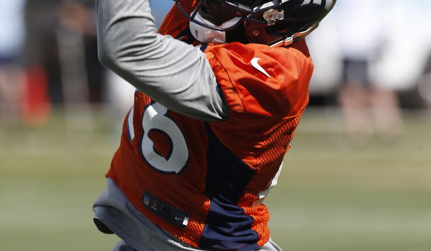 FILE - In this Friday, Aug. 7, 2015, file photo, Denver Broncos defensive back Darian Stewart pulls in a pass during drills at the team's NFL football training camp in Englewood, Colo. Stewart, who followed head coach Gary Kubiak from Baltimore to Denver last off season, has helped the Broncos rise to the top rankings in defense. (AP Photo/David Zalubowski, File)