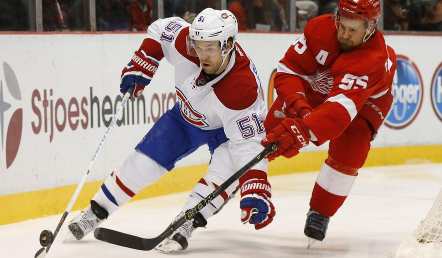 Detroit Red Wings defenseman Niklas Kronwall (55) defends Montreal Canadiens center David Desharnais (51) in the first period of an NHL hockey game Thursday, Dec. 10, 2015 in Detroit. (AP Photo/Paul Sancya)