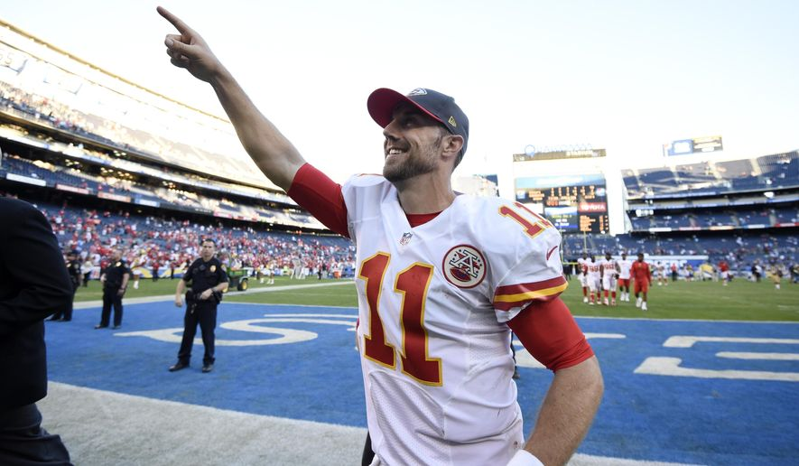 FILE - This Nov. 22, 2015 file photo shows Kansas City Chiefs quarterback Alex Smith greeting fans after the Chiefs defeated the San Diego Chargers in an NFL football game, in San Diego. The Kansas City Chiefs will face the San Diego Chargers again on Sunday, Dec. 13, 2015. (AP Photo/Denis Poroy, file)