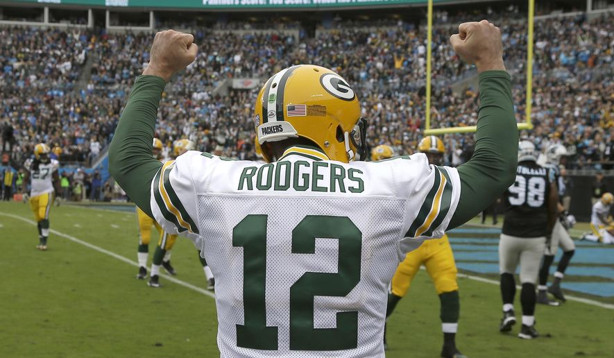 FILE - In this Nov. 8, 2015, file photo, Green Bay Packers' Aaron Rodgers (12) celebrates a touchdown against the Carolina Panthers during the first half of an NFL football game in Charlotte, N.C. The Packers take on the Dallas Cowboys on Sunday in Green Bay Wisc.  (AP Photo/Bob Leverone, File)
