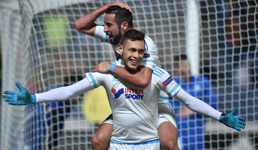 Lucas Ocampos of Olympique Marseille, front, celebrates with teammate  Lucas Silva after scoring during the group F Europa League soccer match between Slovan Liberec and Olympique Marseille, in Liberec, Czech Republic, Thursday, Dec. 10, 2015. Olympique Marseille defeated Slovan Liberec 4:2. (Radek Petrasek/CTK via AP ) SLOVAKIA OUT