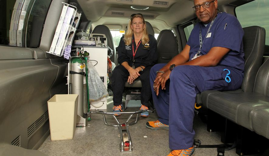 ADVANCE FOR MONDAY DEC. 14, 2015 AND THEREAFTER - Shriners Hospital for Children flight nurses Stacey Brewster, left, and Gene McGowen are part of a team that fly around the world to pick up a patient severely burned needing to come to Galveston. Shriners Hospital for Children's specially trained flight nurses that make up the hospital's air transport program have helped bring almost 1,500 patients to the Galveston burn hospital since 1985.  (Jennifer Reynolds/The Galveston County Daily News via AP) MANDATORY CREDIT