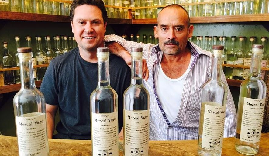 ADVANCE FOR WEEKEND EDITIONS, DEC. 12-13 - In this photo taken, Dec. 2, 2015, Judah Kuper, left, of Vago mezcal is one of several Americans responsible for mezcal's growing popularity the United States and the growth of the industry in Mexico. His father-in-law, right,, Aquilino Garcia Lopez, once an undocumented worker in the U.S., is now a mezcal producer in Oaxaca City, Mexico. (Alfredo Corchado/The Dallas Morning News via AP) MANDATORY CREDIT; MAGS OUT; TV OUT; INTERNET USE BY AP MEMBERS ONLY; NO SALES