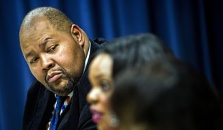Flint City Council President Kerry Nelson listens during a news conference, Thursday, Dec. 10, 2015, at City Hall in Flint, Mich., about adding supplemental phosphates to the city's water. The city says phosphates are being added to drinking water in an effort to help deal with problems with lead caused by the city's earlier use of Flint River water. (Jake May/The Flint Journal-MLive.com via AP) ** FILE **