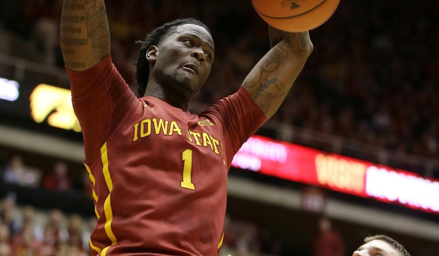 Iowa State forward Jameel McKay dunks the ball over Iowa center Adam Woodbury, right, during the first half of an NCAA college basketball game, Thursday, Dec. 10, 2015, in Ames, Iowa. (AP Photo/Charlie Neibergall)