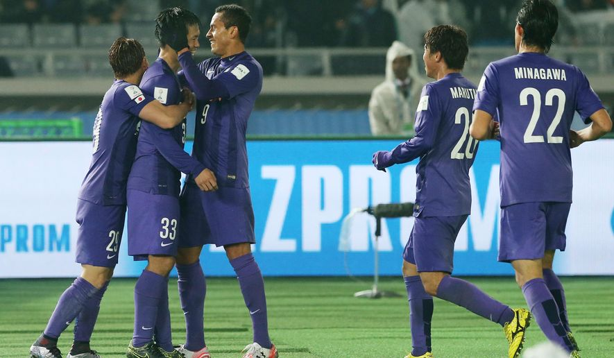 Sanfrecce Hiroshima player's congratulate teammate Tsukasa Shiotani, second left, after he scored their second goal during their match against Auckland City FC at the FIFA Club World Cup soccer tournament in Yokohama, near Tokyo, Thursday, Dec. 10, 2015. (AP Photo/Eugene Hoshiko)