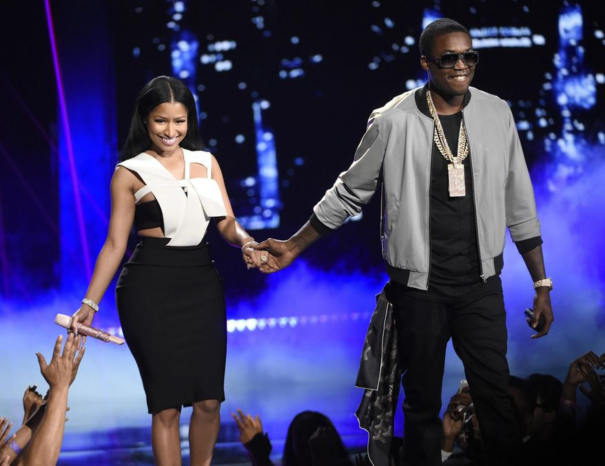 File- This June 28, 2015, file photo shows Nicki Minaj, left, and Meek Mill at the BET Awards at the Microsoft Theater in Los Angeles. Minaj promised to keep boyfriend Meek Mill on the straight and narrow as a judge threatened jail over his latest parole infractions. Minaj testified Thursday, Dec. 10, 2015, in Philadelphia, after a defense lawyer said the couple was seriously discussing marriage. The 33-year-old Minaj disclosed only that they were living together, but conceded she might have more influence over the rapper than his parole officer. (Photo by Chris Pizzello/Invision/AP, File)