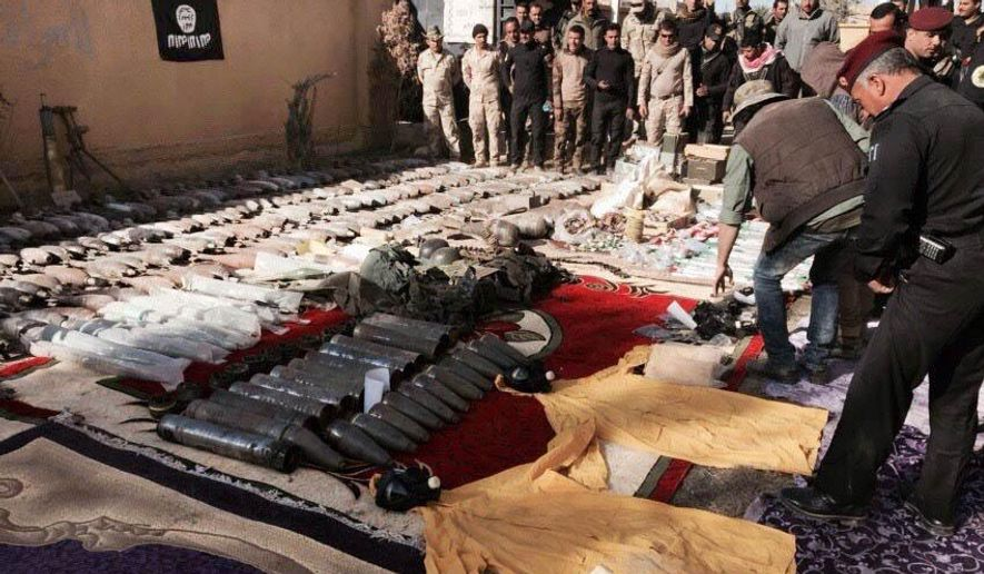 Iraqi security forces look at confiscated Islamic State group weapons and ammunition after regaining control over the last week, in Ramadi, Iraq's Anbar province, 70 miles (115 kilometers) west of Baghdad, Thursday, Dec. 10, 2015. (AP Photo/Osama Sami) ** FILE **