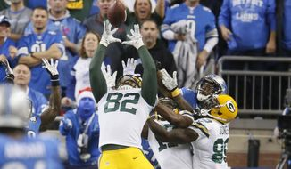 FILE - In this Dec. 3, 2015 file photo, Green Bay Packers tight end Richard Rodgers (82) reaches to catch the game winning pass on the last play of an NFL football game against the Detroit Lions,  in Detroit. There are few veterans better for a young tight end to study on the field than Dallas' Jason Witten. Packers second-year player Rodgers gets to see him up close on Sunday, Dec. 13. (AP Photo/Duane Burleson, File)