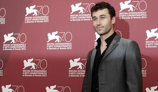 In this Aug. 30, 2013, file photo, actor James Deen poses for photographers at the photo call for the film The Canyons at the 70th edition of the Venice Film Festival in Venice, Italy. The California watchdog agency tasked with ensuring safety in the workplace said it is investigating porn actor Deen's production company after allegations that the reigning star of adult films sexually assaulted women on and off movie sets. (AP Photo/David Azia, File)